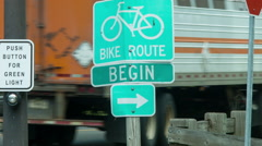 Bike Path Begin sign, crosswalk, Rails-to-Trails Greenway Stock Footage