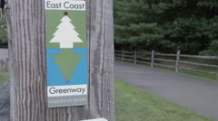 East Coast Greenway Sign, Florida to Maine, Farmington Canal Path Stock Footage