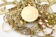 Stock Photo of Vintage jewelry with old gold coin Krugerrand