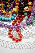 Gemstone jewelry on a plate viewed from above, Stock Photos