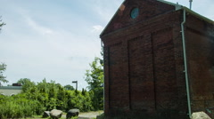 Brick Building in New England, old structure, establshing location shot Stock Footage