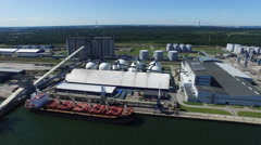 Aerial Shot of Cargo Harbor with Cranes, Silos and Ships. - stock footage