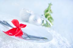 fork and knife on white plate - stock photo