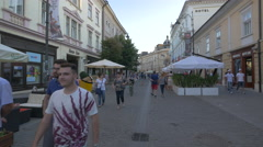 Adults and young people walking on Nicolae Balcescu street, Sibiu Stock Footage