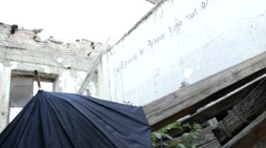 Nazi ghetto umbrella in a ruin house performance RP Stock Footage