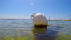 white buoy in the water - stock footage