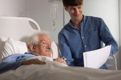 Grandson visiting grandpa in hospice Stock Photos