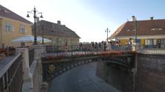 View of the beautiful Liars Bridge with people walking on it, Sibiu Stock Footage