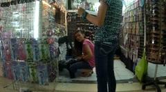 Sales Ladies tending accessory store Stock Footage