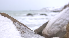 Refocusing the rocks at the lighthouse. Slow motion. Stock Footage