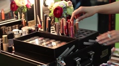 Make-up artist in beauty salon cosmetics sorts before reception client - stock footage