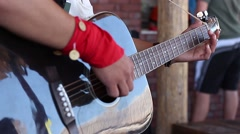 Musician strums the guitar melody close-up, changing focus - stock footage