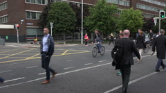 People cycle and walk home from work, city centre, Dublin, Ireland Stock Footage