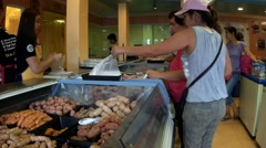 Woman taking plastic bag at Meaty Shop - stock footage