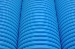 Blue curvilinear tubes - stock photo