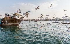 DUBAI, UAE-JANUARY 18: Traditional Abra ferries on January 18, 2014 in Dubai, Stock Photos