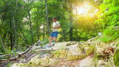 Forest jogging / Running downhill 2 People - 4k - stock footage