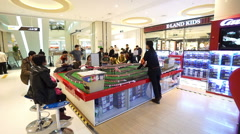 The children watch their cars racing in the shopping mall of Beijing, China Stock Footage
