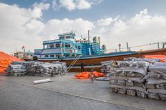 DUBAI, UAE-JANUARY 18: Traditional Abra ferries on January 18, 2014 in Dubai, - stock photo