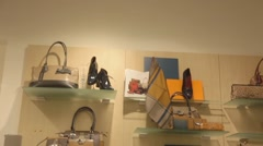 Bags and shoes on shelf Stock Footage