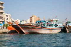 DUBAI, UAE-JANUARY 20: Traditional Abra ferries on January 20, 2014 in Dubai, - stock photo