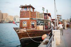 DUBAI, UAE-JANUARY 18: Traditional Abra ferries on January 18, 2014 in Dubai, - stock photo