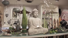 White Buddha statue on table Stock Footage