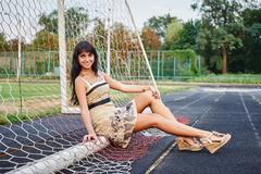 Beautiful young woman on the football field Kuvituskuvat