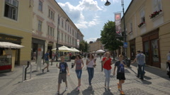 Five teenagers eating icecream and walking on Ncoale Balcescu street, Sibiu Stock Footage
