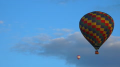 Flying hot air Balloons 13 - Multicolored balloon flying in blue sky 2 - stock footage