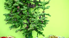 Christmas tree with cones and tinsel not decorated under tree on a green - stock footage