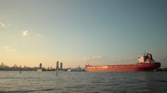 Freighter Docked At Sunset Stock Footage