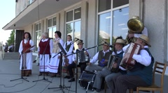 Folk musicians sing and entertain citizen people in city. 4K Stock Footage