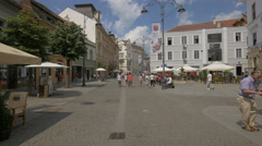 View of Nicolae Balcescu Street and tourists walking on it, Sibiu Stock Footage