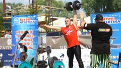 Strongmen compete in lifting heavy barbell Stock Footage