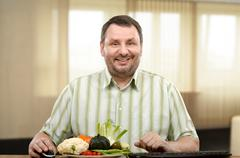 Adult learner of nutrition coach - stock photo