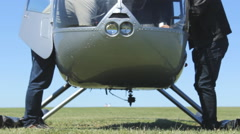 Helicopter on the field prepare for flight 3 Stock Footage