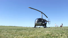 Helicopter on the field prepare for flight 6 Stock Footage