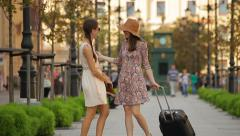 Happy female friends meeting in the city after enjoying a trip Stock Footage