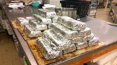 Piles of archipelago loaves, on a table, in a bakery Stock Footage