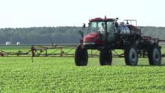 Stock Video Footage of Farmer spraying soybean field