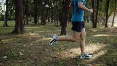 Man fitness wellbeing outdoors trail running - stock footage