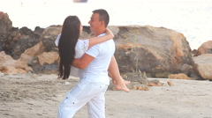 Couple walking on beach. Young happy interracial couple walking on beach Stock Footage