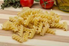 Raw fusilli pasta - stock photo