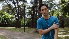 Running man gets heart attack Stock Footage
