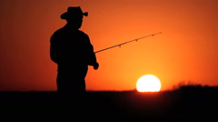 Fisherman at sunrise time. Brazil, Mato Grosso, Pantanal Stock Footage