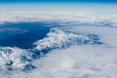 Snow-capped mountains - view from above - stock photo