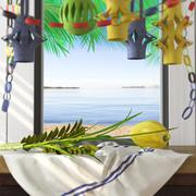Symbols of the Jewish holiday Sukkot with palm leaves and sea beach - stock photo