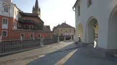 Man selling crayon portraits in front of House of Arts, Sibiu Stock Footage