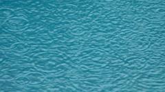 Wave of rain drop in swimming pool Stock Footage